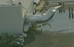 Jet crashes into Chino's airport hangar during engine test!